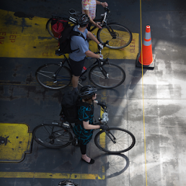 Bicyclists Ready to Depart by Richard Graham - Transportation Bicycles ( bicyclists, street scene )
