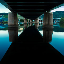 A Peek Under The Railway-Bridge by Lillian Molstad Andresen - Buildings & Architecture Bridges & Suspended Structures ( water, hills, silhouette, line, reflections, railway-bridge, architecture, norway, city, drammen, contstruction, buildings, trees, bridge, river,  )