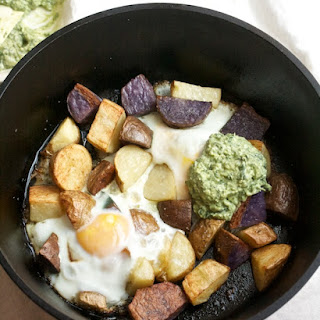 Crispy Potatoes with Baked Eggs and Pesto Yogurt