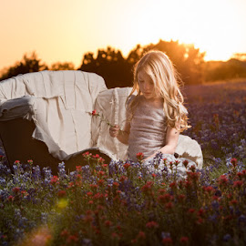 Playing in the flowers by Deborah Chetwood - Babies & Children Child Portraits ( wildflowers, girl, sunset, texas, bluebonnet )