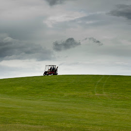 will they finish by Kelvin Watkins - Sports & Fitness Golf ( clouds, hill, golf cart, grass, green )