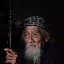 The Old Traditiaonal Musician by Franciscus Satriya Wicaksana - People Portraits of Men ( potrait, old, old man, traditional, musician )