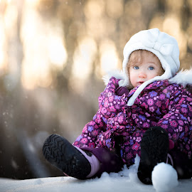 Snow Baby by Mike DeMicco - Babies & Children Child Portraits ( purple, beautiful, little, beauty, cute, pretty, portrait, hat, kid, child, sweet, girl, winter, happy, outdoor, snow, baby, light )