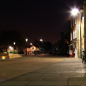 York Street by Ron Jnr - City,  Street & Park  Night ( fence, bike, night photography, buildings, street lights, shadows, street photography )