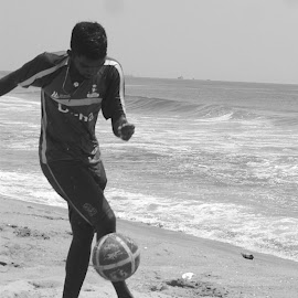 world in motion  by Karpagam Kannan - Sports & Fitness Soccer/Association football ( ball, black and white, sports, sea, beach, men, black and white phography, motion, soccer,  )