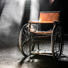 a wheelchair with a story by Marco Bontenbal - Artistic Objects Healthcare Objects ( history, urbex, lost, wheelchair, beautiful, abandoned )