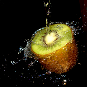 Kiwi Splashing by Premkumar Antony - Food & Drink Fruits & Vegetables ( water, stock, vitamins, diet, kiwi, food, fruits, health, cut kiwi, premkumar antony )