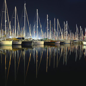Proudly Reflected by Marc-Antoine Kikano - Transportation Boats ( reflection, sailboats, yacht, dark, reflections, sea, night, sailboat )