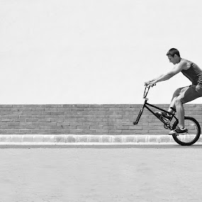 Wheel unchained by Adrienn Liker - Sports & Fitness Cycling ( bike, wheel, black and white, bmx, sport, man, bicycle )
