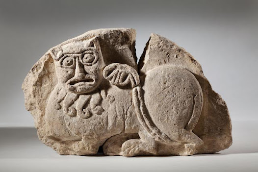 This early 12th century tympanum, originally from a doorway, was found during excavations at St Mary's Priory, Thetford. The original site of the priory was moved from the south side of the town to the north where there was more space. In 1114, the monks moved into the new buildings, of which this sculpture was a part. The sculpture depicts a lion in a classic Romanesque style with the animal's mane ending in little curls. Similar lions appear on the Bayeux Tapestry.