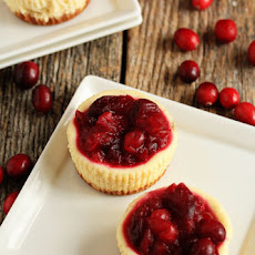 Individual Cheesecakes with Orange-Cranberry Sauce