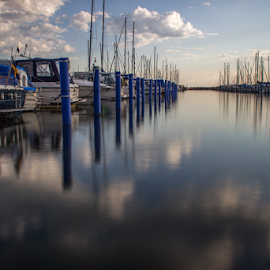 Daytime by Julija Moroza Broberg - Landscapes Waterscapes ( reflection, smooth, harbor, waterscape, harbour, yacht, clouds and sea, reflections, little, seaside, jetty, coastline, coast, mast, daytime, sailing, råå, pier, helsingborg, water, clouds, sweden, boats, sea, seascape, sailboat, blue, summer, yacht club, local, town, daylight )