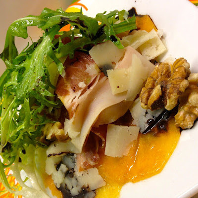 Persimmon Carpaccio with Prosciutto, Manchego, and Pear Balsamic Drizzle
