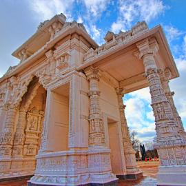Gateway to Swami Narayan Temple, Chicago by Dipali S - Buildings & Architecture Other Exteriors ( marble, monk, gateway, exterior, stone, shiva, architecture, religion, hindu, sky, chicago, place, structure, swami narayan temple, art, tourism, temple, sculpture, landmark, statue, classical, contemplation, column, palace, culture, hope, god, dome, landscape, hinduism, clear, tranquil, style, india, spirituality, east, clouds, building, miracle, indian, traditional, ornamental, history, tower, color, blue, praying, cloud, tour, ethnicity )