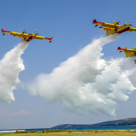 Swans by Darko Maretić - Transportation Airplanes ( water, airtanker, airplane, drop, sea, yellow, in flight, canadair, fire, flight, sky, plane, firefighting, cl415, group )