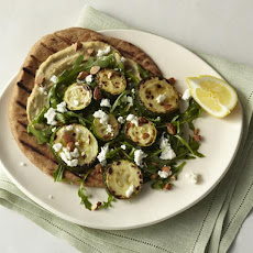 Roasted Zucchini Flatbread with Hummus, Arugula, Goat Cheese, and Almonds