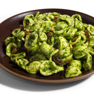 Pasta with Arugula Pesto, Sun-Dried Tomatoes, and Pine Nuts