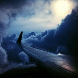 Shoot for the stars...and if you land on the clouds...cool :)  by Dave Desvousges - Transportation Airplanes ( clouds, iphoneography, minneapolis, airplane, iphone )