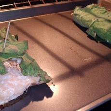 Salmon Wrapped in Fig Leaves With Baked Kale