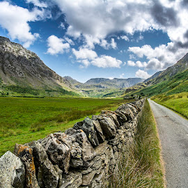 Long, long way by Marek Saj - Landscapes Mountains & Hills ( clouds, hills, rocky, green, beautiful, deeply, meadows, valley, road, fence, mountains, sky, meadow, stones, deep, rocks, fields )