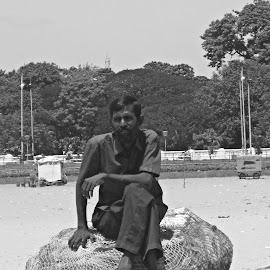 tired man by Venkata Krishnan - People Portraits of Men ( #blackandwhite #man #beach #tired #sand )