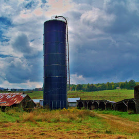 by Delores Mills - Buildings & Architecture Other Exteriors ( clouds, farm, agriculture, silo, fields )