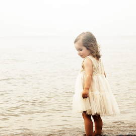 Testing the water by Joseph Humphries - Babies & Children Children Candids ( water, babies, dress, beautiful, precious, children, candid, ocean, highkey )