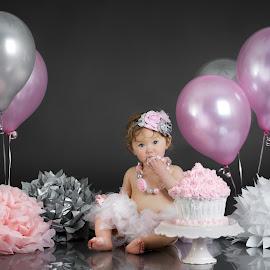 Emma Cake Smash by Mike DeMicco - Babies & Children Child Portraits ( cake, birthday, cake smash, little, smash, fun, gray, cute, balloons, pretty, cakesmash, girl, happy, pink, grey, baby, flowers, toddler )