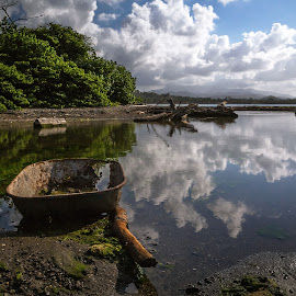 Left behind by Alejo Cedeno - Landscapes Cloud Formations ( clouds, panama, water, reflection, nature, blue, colorful, green, beach, woods, wheel barrel, river )
