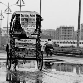 A rickshaw by Manindra Mukherjee - Transportation Other ( black and white, street, rickshaw, transportation, people, bicycle, street photography )