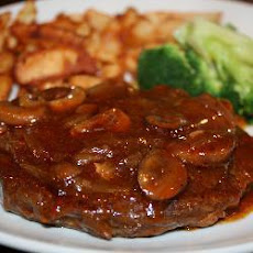 Braised Steak With Onions And Mushrooms In A Brandy Beef Gravy