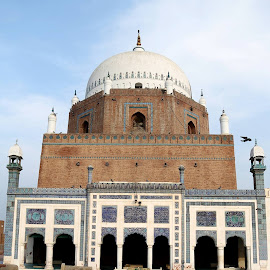 Baha-ud-din Zakariya (Persian: بہاؤ الدین زکریا) (1170-1267) was a Sufi of Suhrawardiyya order (tariqa). His full name was Abu Muhammad Bahauddin Zakariya. He was a Hashmi from the aulad of Hadhrat Asad Ibn Hashim.Sheikh Baha-ud-Din Zakariya known as Bahawal Haq was born at Kot Kehror (Karor Lal Eason), a town of the Layyah District near Multan, Punjab, Pakistan, around 1170. His grandfather Shah Kamaluddin Ali Shah Qureshi arrived in Multan from Mecca en route to Khwarezm where he stayed for a short while. In Tariqat he was the disciple of renowned Sufi master Shaikh Shahab al-Din Suhrawardi who awarded him Khilafat only after 17 days of stay at his Khanqah in Baghdad. For fifteen years he went from place to place to preach Islam and after his wanderings Bahawal Haq settled in Multan in 1222.Baha-ud-din Zakariya died in 1268 and his mausoleum, Darbar Hazrat Baha-ud-din Zakariya, is located at Multan. The mausoleum is a square of 51 ft 9 in (15.77 m), measured internally. Above this is an octagon, about half the height of the square, which is surmounted by a hemispherical dome. The mausoleum was almost completely ruined during the siege of 1848 by the British, but was soon afterward restored by the Muslims. by Sarina Farhan - Buildings & Architecture Statues & Monuments