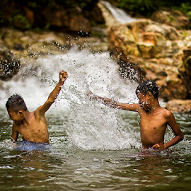 fighting in the river by Fadli 'Zazg' - Babies & Children Child Portraits