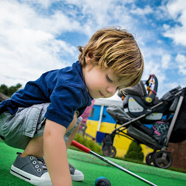 Hole in One by Mike DeMicco - Babies & Children Children Candids ( child, golfing, golf, handsome, boy, hole )