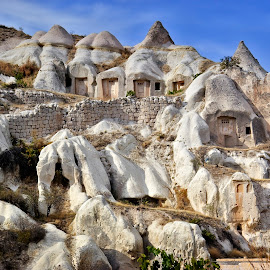 Cave Dwellings Cappadocia Turkey by Graham Mulrooney - Buildings & Architecture Homes ( cave dwelling, caves, cave dwellings, bizarre, cave, landscape, barren, nature, rock formations, horizontal, goreme, ancient dwellings, turkey, stones, cappadocia, wall )