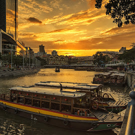 Boats of Singapore River by Kristianus Setyawan - Transportation Boats ( skyline, city scene, waterscape, golden sky, boats, cityscape, landscape, singapore, golden sunset, singapore river, clarkequay, nature, sunset, burning sunset, skyporn, landscape photography, nature photography, sunset scenery, city skyline, golden hour, skyscape )