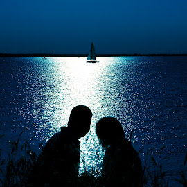 Blue Moon by Dale Frazier - People Couples ( water, isolated, joy, lake, ocean, fun, team, sailboat, fantasy, teamwork, sillohette, blue, peace, dark, couple, engagement,  )