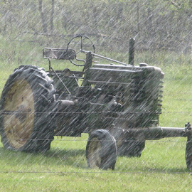 rain has stalled  by Kimberly Mehrer - Transportation Other ( field, grass, john deere, trees, tractor, rain )