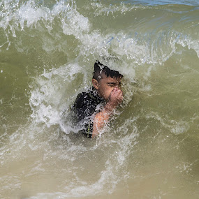 Boy dodging the waves by Kimberly Arend Porter - Sports & Fitness Surfing ( waves, fun, beach, swimming, breath )