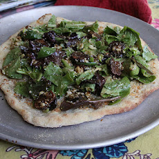 Smoked blue cheese and mixed greens flatbread with fig, pecan vinaigrette