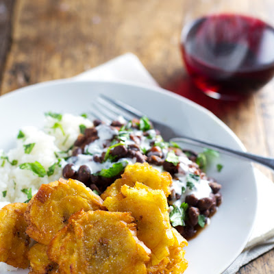 Tostones: Puerto Rican Fried Plantians with Rice and Beans