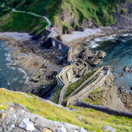 Stairs to San Juan de Gaztelugatxe (miniature) by Justin Murazzo - Landscapes Travel ( stone, beach, long, spain, religion, bay of biscay, walkway, ring, church, grass, cliff, tourism, steps, trek, bell, tourist, san, iberia, bay, cantabrian, walk, green coast, san juan de gaztelugatxe, peninsula, christian, europe, christianity, rocky, bilbao, ocean, beauty, north, gaztelugatxe, coast, miniature, stairs, tide, rocks, juan, water, look, edge, biscay, waves, green, beautiful, steep, sea, bakio, northern spain, scenic, basque country, effect, blue, color, scenery, down, hike )