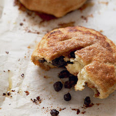 Edd Kimber fills his eccles cakes with a spiced fruit and curd mixture