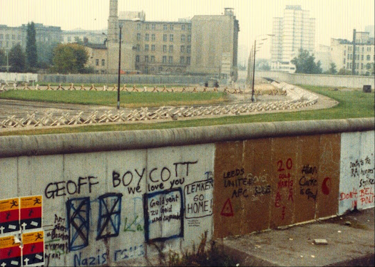 The graffiti on the Western sidewas more light-hearted than the reality that lay on beyond it.
