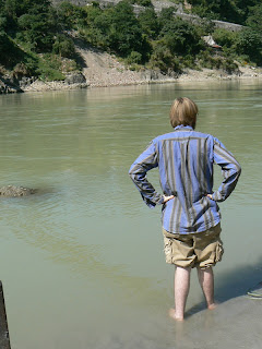 Nathaniel contemplates theology with his feet in the Ganges.