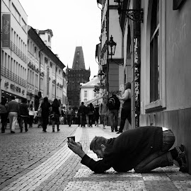 Prayers in Prague by Ken Susi - City,  Street & Park  Street Scenes ( prayer, god, black and white, street, poor, street photography, vacation, beggar, homeless, praying, czech republic, money, pray, street scenes, classic )