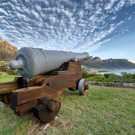 The Noon Gun has been a historic time signal in Cape Town, South Africa since 1806. The gun is situated on Signal Hill, close to the centre of the city. by Ryan Torres - Buildings & Architecture Statues & Monuments ( twelve appostles, beach, travel, cannon, city, military, nature, tree, capetown, flower, tourism, sunset landscape, cape town, tourist, bay, day, town, panoramic, canon, pirates, sunset sky, reflection, noon gun, cape, cable car, south africa, ocean, landscape, coastline, panorama, coast, war, lions head, mountains, tablemountain, africa, rocks, banner, water, beautiful, signal hill, sea, gun, table mountain, camps bay, sunset, background, cloud, summer, sunrise )