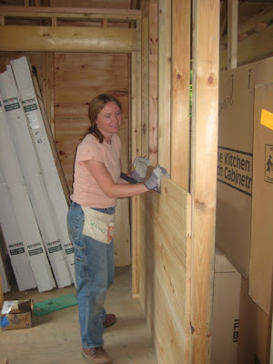 Wendy builds up the wall between the hallway and the pantry closet.
