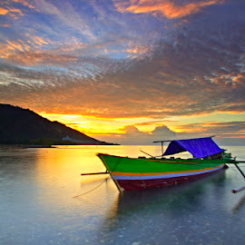 Lonely boat in a sunset by Brain Langelo - Transportation Boats