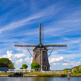 Windmill near Amsterdam by Alexander Karnadi - Buildings & Architecture Other Exteriors ( sunny weather, contrast, blue sky, sunny, amsterdam, good weather, windmill, netherlands, river )